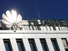 The logo of China's Huawei Technologies shines in the bright sun over the headquarters of the telecommunications giant in Duesseldorf