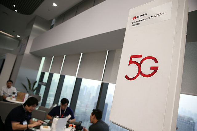 Huawei 5G device is pictured outside an exhibition in Bangkok