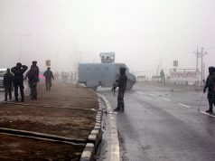 Indian soldiers stand guard near the site of Thursday's suicide bomb attack in Lethpora