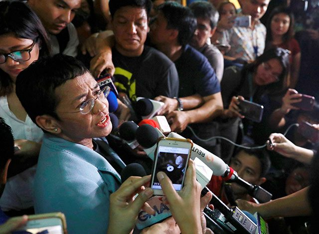 Maria Ressa with reporters