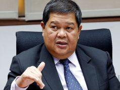 Philippine Central Bank governor Espenilla gestures during an interview with Reuters at the central bank headquarter in Pasay, metro Manila