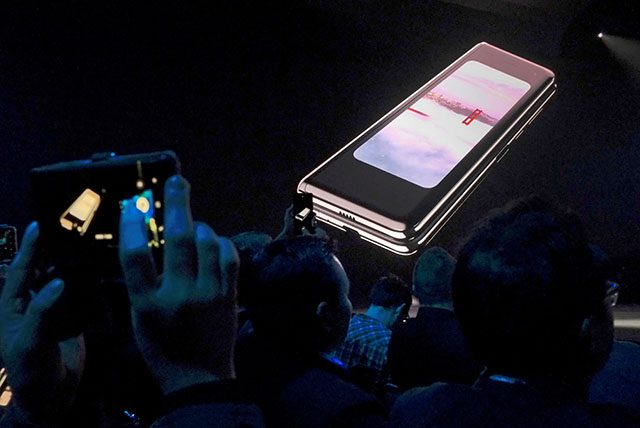 The Samsung Galaxy Fold phone is shown on a screen at Samsung Electronics Co Ltd's Unpacked event in San Francisco