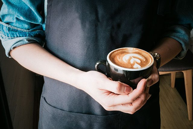 Barista with a cup