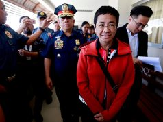 Rappler CEO and Executive Editor Ressa is escorted by police after posting bail in Pasig Regional Trial Court in Pasig City