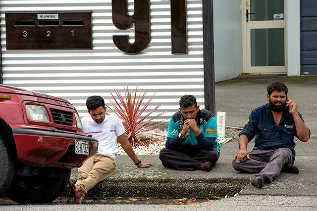 Grieving members of the public following a shooting at the Al Noor mosque in Christchurch