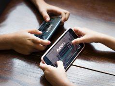 Playing mobile games Interaksyon