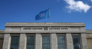 A flag is pictured outside the European headquarters of the United Nations in Geneva
