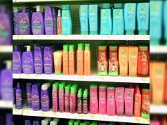 Shampoo bottles in a rack