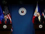 Philippine Foreign Secretary Teodoro Locsin Jr. speaks to the media as U.S. Secretary of State Mike Pompeo smiles at him at the Department of Foreign Affairs in Pasay City