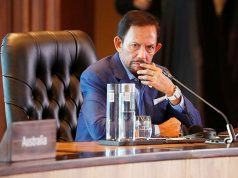 Brunei's Sultan Hassanal Bolkiah attends the retreat session during the APEC Summit in Port Moresby, Papua New Guinea