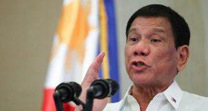 Duterte gesturing in a speech