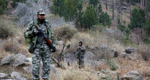 Pakistan's army soldiers guard the area, after Indian military aircrafts struck on February 26, according to Pakistani officials, in Jaba village, near Balakot