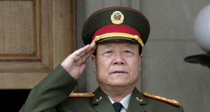 China's then Central Military Commission former Vice Chairman General Guo Boxiong stands at attention during the playing of the national anthem before a meeting at the Pentagon in Washington