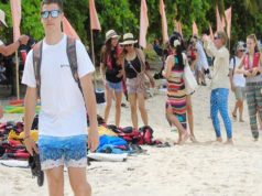 Foreigners in a beach