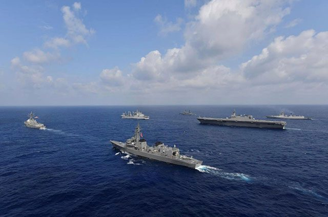 Vessels from the U.S. Navy, Indian Navy, Japan Maritime Self-Defense Force and the Philippine Navy sail in formation at sea