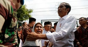 Joko Widodo embraces his supporters
