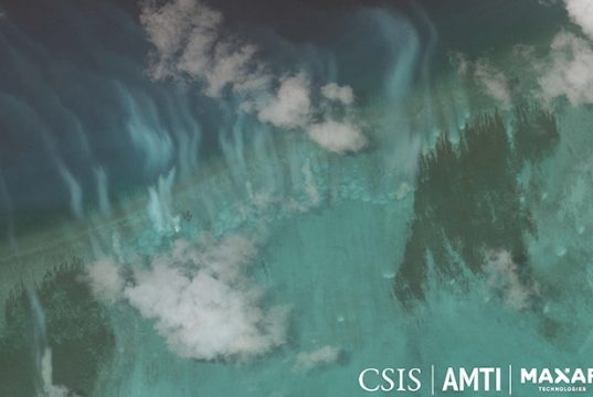 Satellite image of sediment plumes created by the activity of clam harvesting boats at Bombay Reef