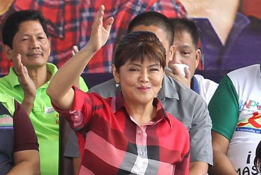 Imee Marcos waving at crowds