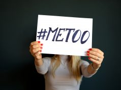 Woman holding MeToo sign