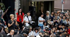 Hong Kong pro-democracy singer Denise Ho speaks at a free concert in Hong Kong
