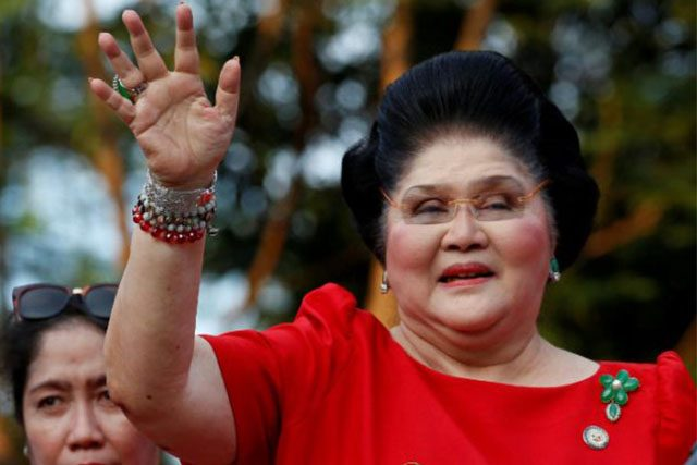 Imelda Marcos waves to the crowd