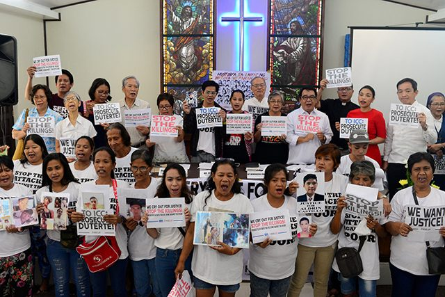 Activists and families of drug war victims display placards during a protest against the war on drugs by President Rodrigo Duterte in Quezon city