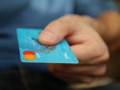 Person holding a credit card