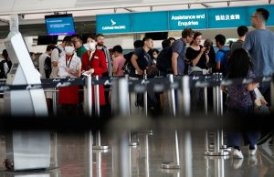 Passengers queue at Cathay Pacific's counters a day after the airport was closed due to a protest, at Hong Kong International Airport, China