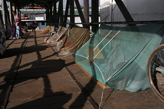 Homeless people sleep under the mosquito net to protect themselves from a recent dengue outbreak in Dhaka