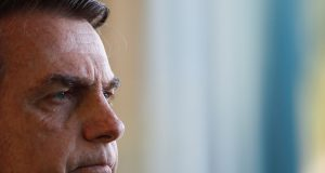 Brazil's President Jair Bolsonaro looks on during a news conference with Chile's President Sebastian Pinera (not pictured) at the Alvorada Palace in Brasilia