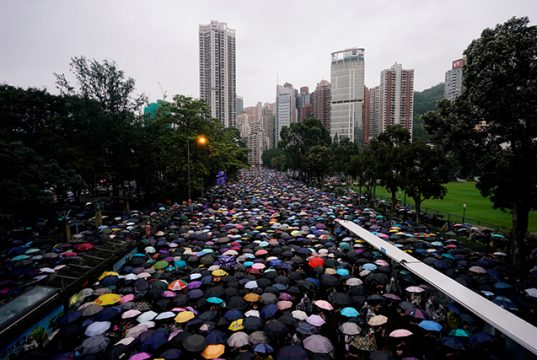 Anti-extradition bill protesters march to demand democracy and political reforms, in Hong Kong