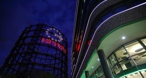 """Young activists install giant """"carbon clock"""" at former gasometer in Berlin"""