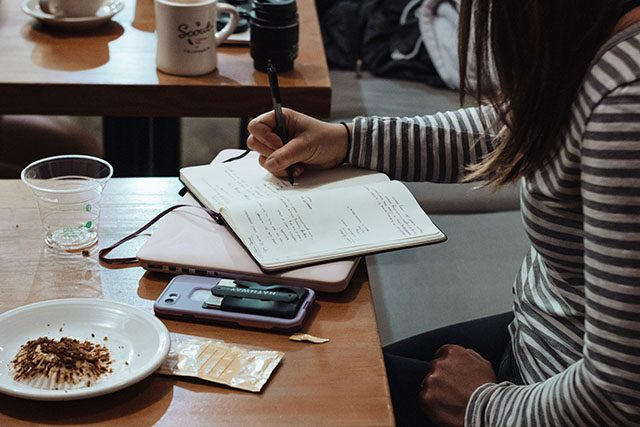 Student studying in a cafe