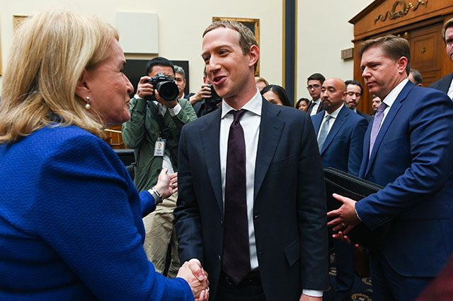 Facebook Chairman and CEO Mark Zuckerberg greets Rep. Garcia after testifying at a House Financial Services Committee hearing in Washington
