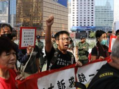 Hong Kong protester holding banners