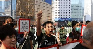 Hong Kong protester holding banners