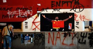 A poster of NBA's Los Angeles Lakers player LeBron James with China national flag is seen outside Mong Kok Mass Transit Railway (MTR) station during an anti-government protest, in Hong Kong