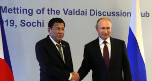 Russia's President Putin shakes hands with Philippines' counterpart Duterte during their meeting in Sochi