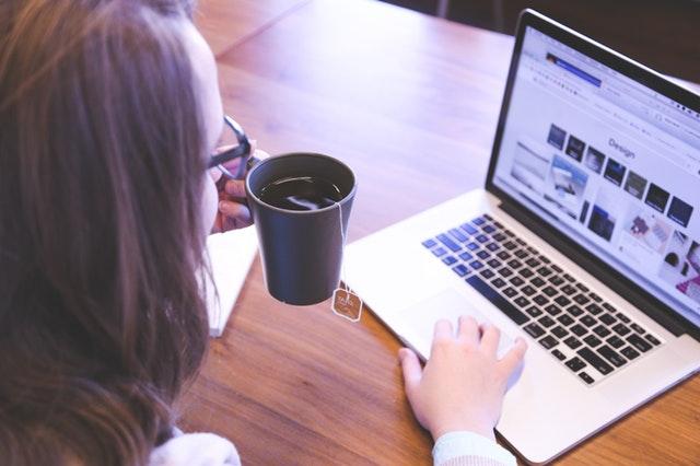 Woman browsing laptop