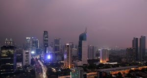 General view of a business district at sunset in Jakarta