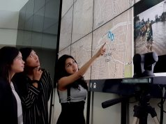 Nashin Mahtani (right) points to a flooding map in Jakarta, Indonesia in February 2017. Handout/Yayasan Peta Bencana