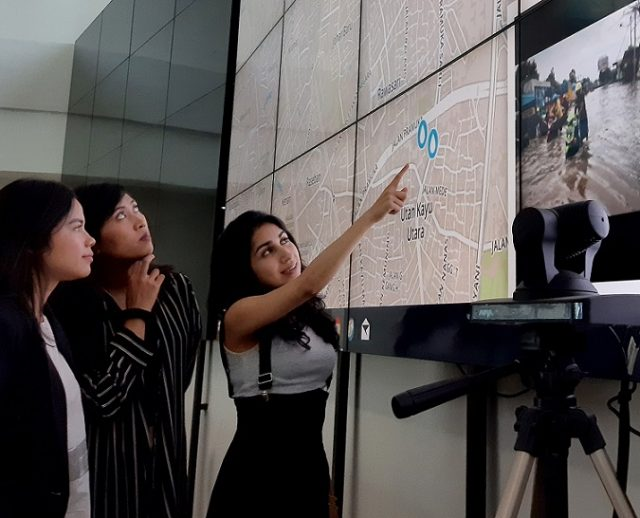 Nashin Mahtani (right) points to a flooding map in Jakarta, Indonesia in February 2017. Handout/Yayasan Peta Bencana