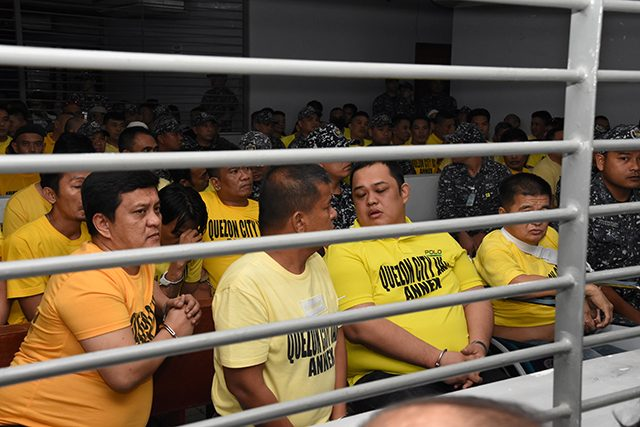Members of the Ampatuan family sit with other suspects in the 2009 Maguindanao Massacre at the promulgation of the case, inside a prison facility in Taguig City