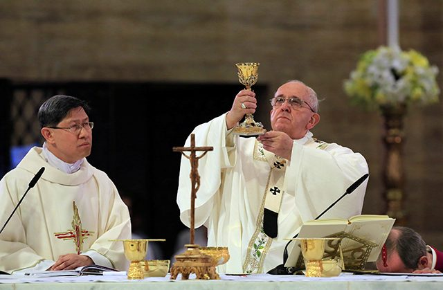 FILE PHOTO: Pope Francis holds a mass at the Cathedral church in Manila