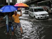 Filipinos wading in the flood