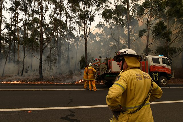 Rural Fire Service volunteers and Fire and Rescue NSW officers contain a small bushfire which closed the Princes Highway south of Ulladulla