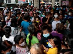 A long queue is formed outside a medical supply store that sells face masks, a day after Philippine government confirmed first novel coronavirus case, in Manila, Philippines