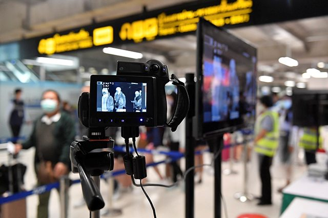 Images are seen on thermographic devices checking the temperatures of arrival passengers at the Bangkok's Suvarnabhumi International airport in Thailand