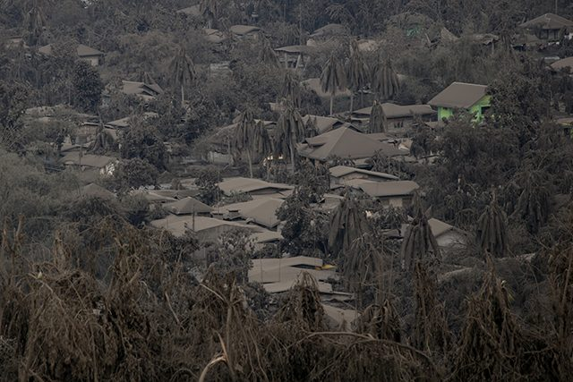 Houses covered with ashes from the erupting Taal Volcano are pictured in Talisay