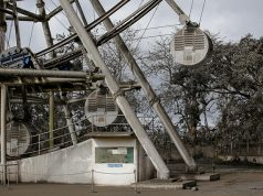 A ferris wheel is covered with volcanic ash in a park in Tagaytay City